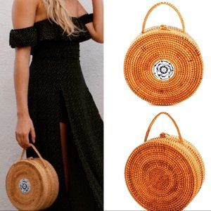 Handbags - Round handwoven straw bag